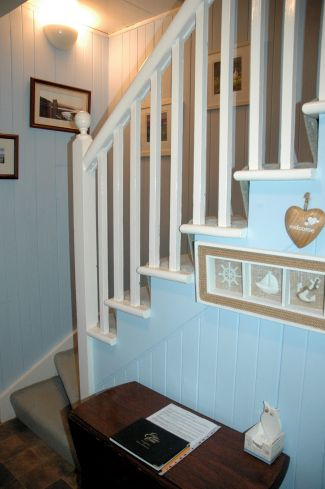 Hall stairs and landing bruaich cottage lochcarron - Front door opens to kitchen ...